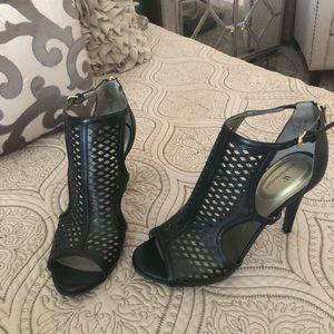 Black caged heels
